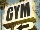aged and worn gym sign - 209404256