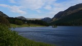 Stunning scenery of Crummock Water and surrounding mountains in Lake District in England, United Kingdom, blurry foreground grass - 209405438