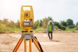Surveyor engineer making measure at the land - 209411075
