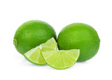 fresh green lime with slice isolated on white background