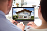 Two Businesspeople Looking At House - 209437238