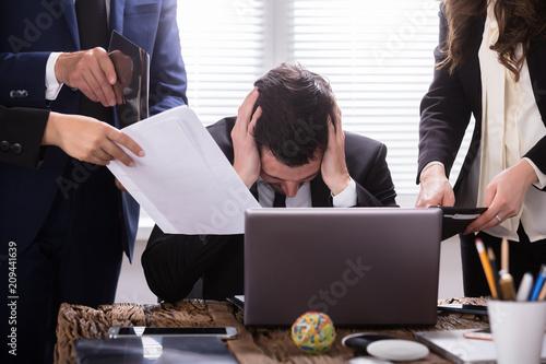 Fridge magnet Stressed Businessman Sitting In Office