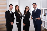 Portrait Of A Happy Businesspeople - 209442205