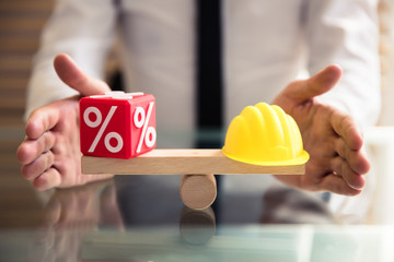 Hand Protecting Balance Between Percentage And Yellow Hardhat