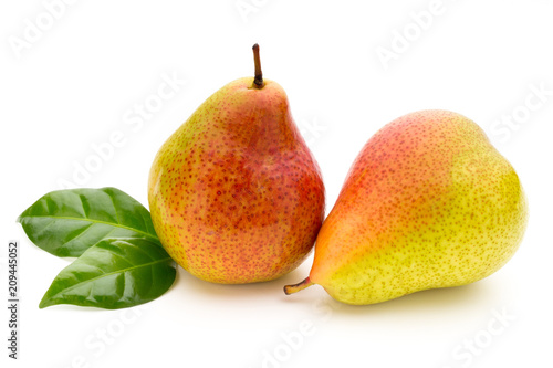 Foto Murales Fresh bio pear with leaves on isolated white background.