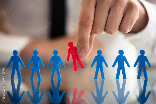 Businessperson Picking Red Human Figures