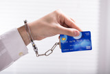 An Arrested Person Hand Linked To Credit Card