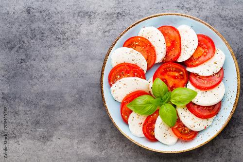 Foto Murales Classic caprese salad. Mozzarella tomatoes and  Basilikum.