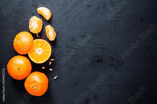 Juicy oranges on black background. Copy space - 209447276