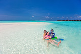 Mother and kids at tropical beach - 209449814