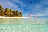Family on a beach - 209449872