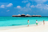 Mother and kids at tropical beach - 209450030