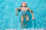 Little girl in swimming pool - 209450033
