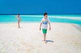 Kids at beach - 209450203