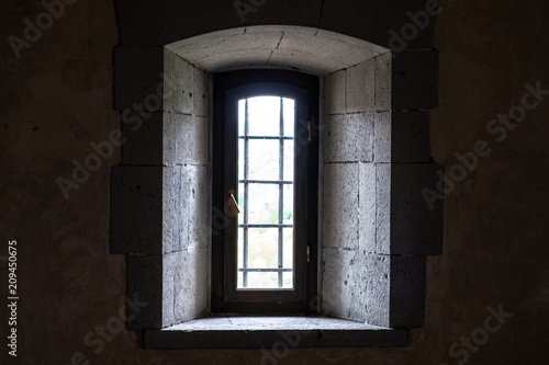 Window in the medieval fortress view from the room. - 209450675