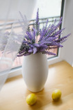 A pot with lavender on wooden background - 209457607