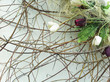 Flower decoration. Simple floral background with branches and dried or artificial flowers. Close-up photo  - 209463098