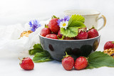 Ripe strawberries and cherries on the kitchen table