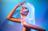 Fashion model girl in colorful bright sparkles and neon lights posing in studio, portrait of beautiful woman, trendy glowing make-up. White hair, colorful make up. Glitter vivid neon makeup - 209494845