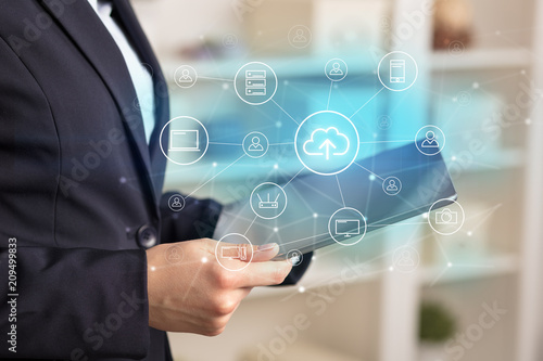 Business woman using tablet with network security and online storage system concept