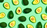 Fresh avocado pattern on a green background flat lay - 209512064
