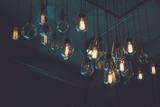 Beautiful vintage luxury light bulb hanging decor glowing in dark. Retro filter effect style. - 209514017