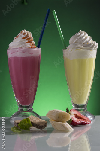 Fotobehang Milkshake milk shake glass with straw on top of ice cream