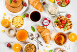 Healthy breakfast eating concept, various morning food - pancakes, waffles, croissant oatmeal sandwich and granola with yogurt, fruit, berries, coffee, tea, orange juice, white background - 209520648