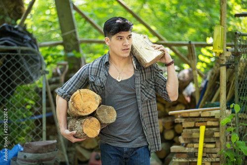 Strong man carrying firewood - 209522874
