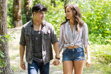 Happy young hispanic couple hiking on a trail - 209523260