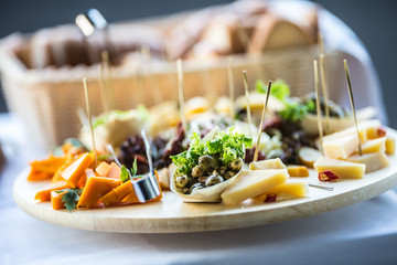 Catering food on wooden board in hotel or restaurant