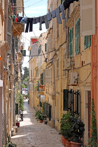 Fototapeta old stone street and houses Corfu town Greece