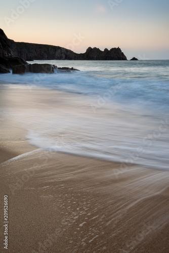 Aluminium Cappuccino Stunning vibrant sunrise landscape image of Porthcurno beach on South Cornwall coast in England