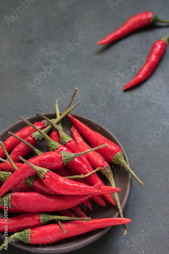 Fotobehang Hot chili peppers Chili in the bowl on a gray background