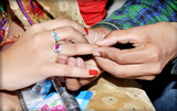 Indian groom putting ring on indian bride - 209534004