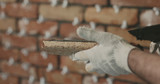 closeup worker applying concrete glue to brick tile - 209538466