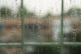 rain drops on a window with fence