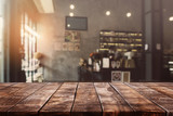 Empty old wood table top and blurred bokeh cafe and coffee shop interior background with vintage filter - can used for display or montage your products.
