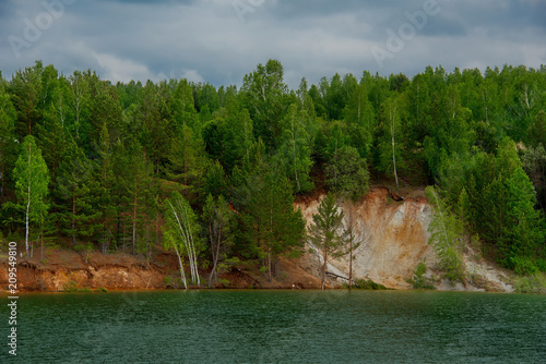 Foto Murales Russia. The South Of Western Siberia. Flooded quarry for copper mining, the increased content of which in the water gives it a blue-green color