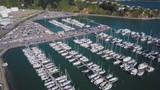 Aerial, beautiful marina full of boats and hillside waterfront homes. - 209551897