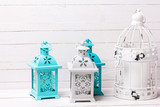 Bright  mint color decorative lanterns on white wooden background. - 209552652