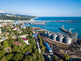 Aerial view of seaport area and industrial district in Tuapse city - 209554634