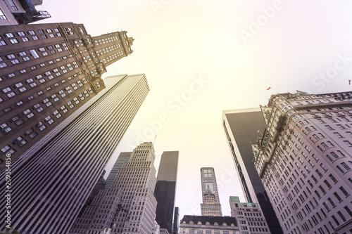 Foto Murales Vintage stylized photo of skyscrapers in Manhattan at sunset, New York City, USA.