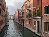 Tranquil back canal with colorful historic houses with balconies and greenery, Venice, Veneto, Italy , a popular tourist destination - 209558077
