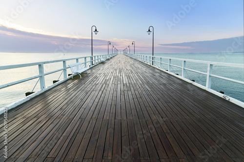 Zdjęcia na płótnie, fototapety na wymiar, obrazy na ścianę : Wooden pier at sea shore, morning view, Gdynia Orlowo poland