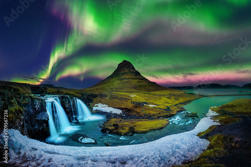 Northern Light, Aurora borealis at Kirkjufell in Iceland. Kirkjufell mountains in winter. - 209567236