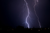 thunderstorm and lightning on a summer night over a sleeping city - 209572828