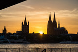 Silhouettes of Cologne at sunset. Cathedrals - 209574023