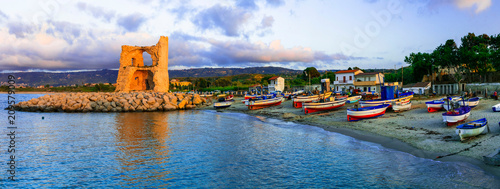 Plexiglas Freesurf Traditional fishing village Briatico with colorful boats and old saracen tower. Calabria, Italy