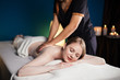 Leinwanddruck Bild - Caucasian woman in wellness beauty spa having aroma therapy massage with essential oil, looking relaxed